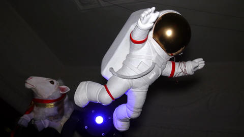 Figure of white astronaut suspend in air. Indoor. doll Footage