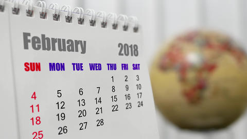 Motion of February 2018 calendar with blur earth globe turning background Live Action