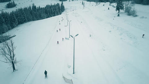 Aerial view of a snow covered alpine skiing slope in winter Footage