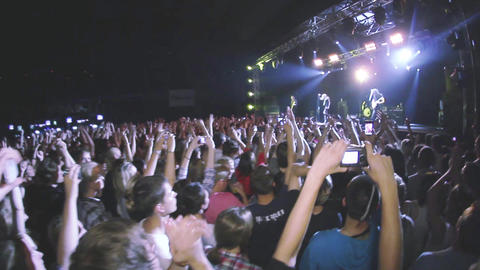 People applauded on live rock concert in nightclub. Band performing on stage Footage