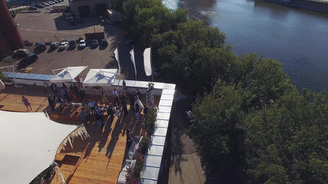 Quadrocopter shoot summer restaurant on roof of brick building in summer day Live Action