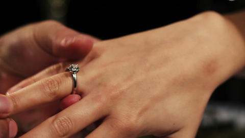 Man put on engagement ring with diamond on woman finger. Proposal. Romantic Live Action
