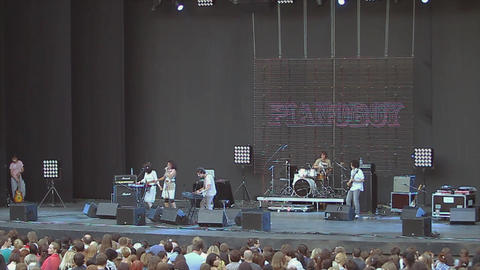 MOSCOW, RUSSIA - AUGUST 23, 2011: Music band perform on stage. Dancing. Live Footage