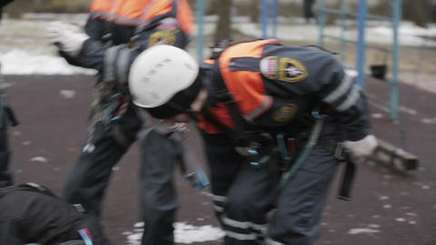 SAINT PETERSBURG, RUSSIA - NOVEMBER 28, 2015: Young rescuers in helmet Footage