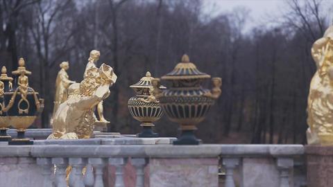 Golden female statues of Grand Cascade fountain in Peterhof Saint Petersburg Footage