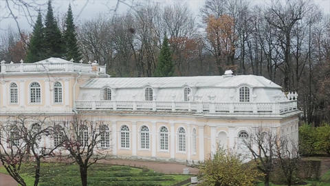 View of white baroque building in park in Saint Petersburg. Autumn day Footage