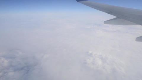 Airplane Wing and Wihte Clouds Footage