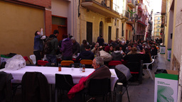 Small city street blocked with many tables, Spanish citizens have outdoor repast Footage