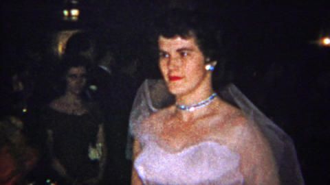 1965: Wedding bride in pink dress solemnly walks down aisle Footage