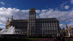 Catalonia Square buildings, panning shot, high contrast sunny evening, fountain Live Action