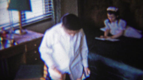 1954: Young boy dressing navy blue pants kids bedroom Footage