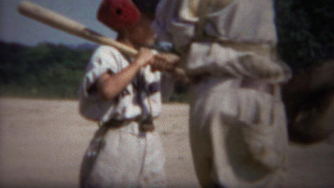 1964: Little league baseball batter hit by wild pitch jumps back Footage