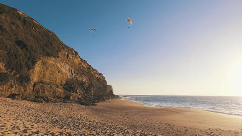 Paragliders Fly Over the Ocean Beach Footage