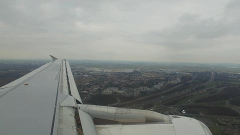 Airplane is Flying Above the City Footage