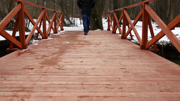4K Man Walking On Bridge In Forest stock footage
