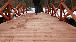 4K Man Walking on Bridge in Forest Footage