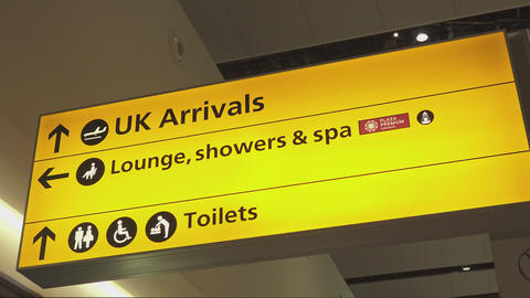 Sign UK Arrivals at London Heathrow Airport Live Action