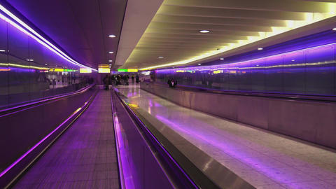 Futuristic walkway between terminals at London Heathrow Airport Live Action
