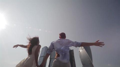 Happy Free Couple Joyful With Arms Raised Footage