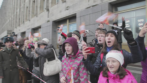 SAINT PETERSBURG, RUSSIA - OCTOBER 27, 2013: Many young people wave flags in Footage