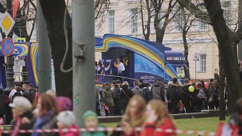 SAINT PETERSBURG, RUSSIA - OCTOBER 27, 2013: Volunteers bus. Dancing people Footage