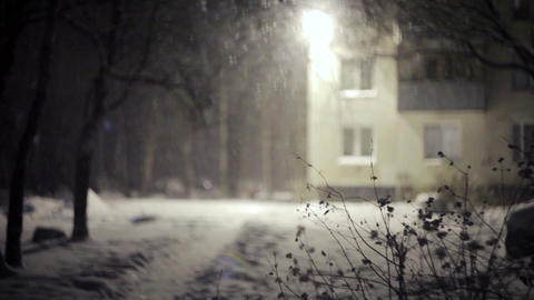 Heavy Snow falling in front of building. Evening Footage