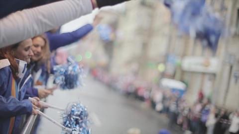 SAINT PETERSBURG, RUSSIA - OCTOBER 27, 2013: Volunteers in gloves wave pom pom Footage