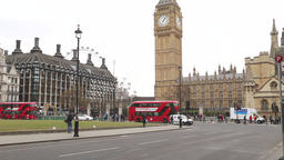 Tourist bus and London bus at Westminster London UK Footage