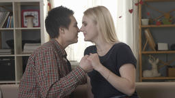 Two young lesbians cute look at each other, wrestle with hands, nose to nose Footage