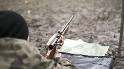 soldier shooting from a rifle on a shooting range Bild