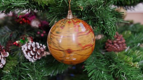 Twisted globe earth ball on Christmas tree Footage