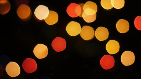 Colorful lights bokeh on black background. Pan Footage