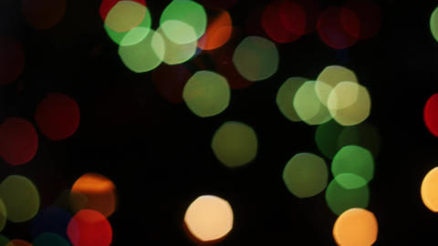 Colorful lights bokeh on black background. Dynamic Footage