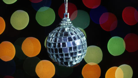 Mirror ball at background of blurred lights. Bokeh Footage
