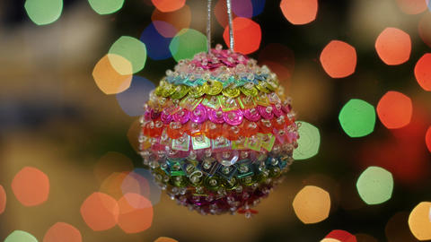 Christmas colorful ball shakes at background bokeh Footage