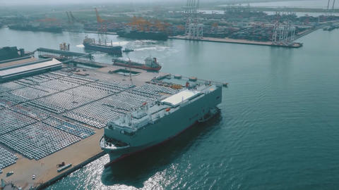 Aerial view Cargo sea port with Sea cargo cranes have cars Live Action