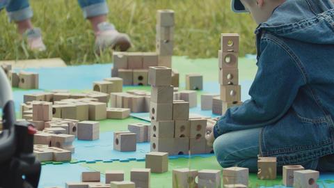 SAINT PETERSBURG, RUSSIA - JUNE 24, 2017: Little kid playing with wooden bricks Footage