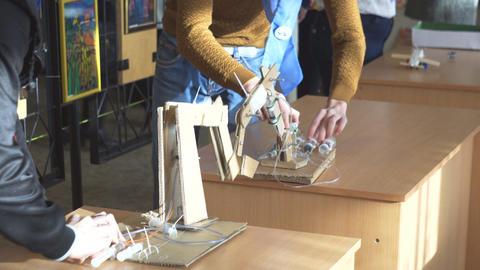 Students test hydraulic models Footage