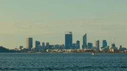 Small Boat Passing By The View Of The Perth City Skyline Footage