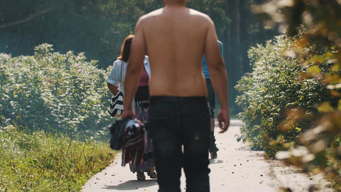 People walking in a park on a sunny day. Man on a rollerblades. Topless man Footage