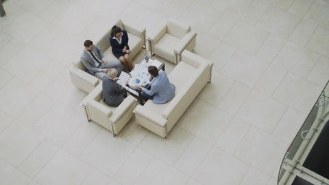 Top view pan shot of group of business people colleagues discussing financial Footage