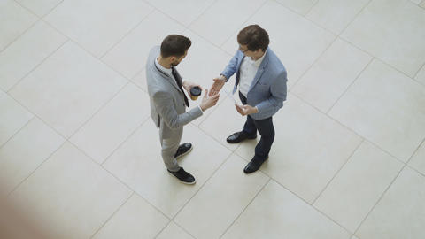 Top view of two businessmen discussing financial report then tell goodbye Footage