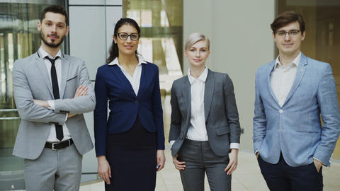 Portrait of group of business people smiling in modern office. Team of Footage