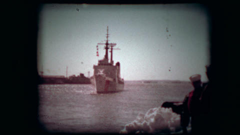 Archival footage of a huge coast guard ship docking Live Action