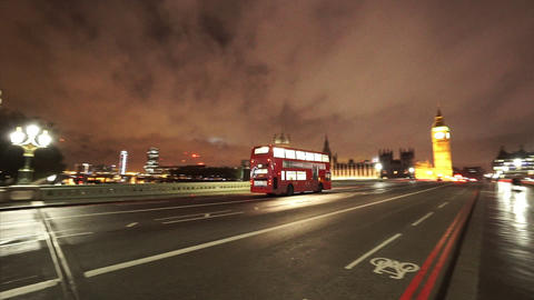 Red Bus driving over Westminster Bridge London - LONDON, ENGLAND NOVEMBER 20, 20 Live Action