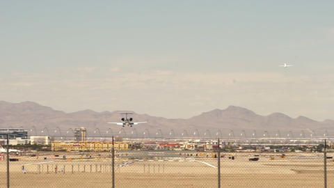 Airplane landing on runway while another airplane is starting – April 18th 201 Footage