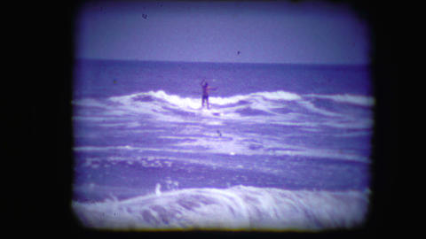 Archival footage of a man surfing Live Action