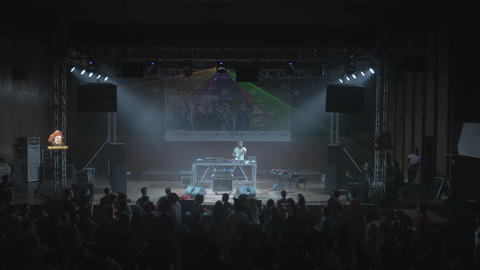 Music festival show with dj and light effects in auditorium hall Footage