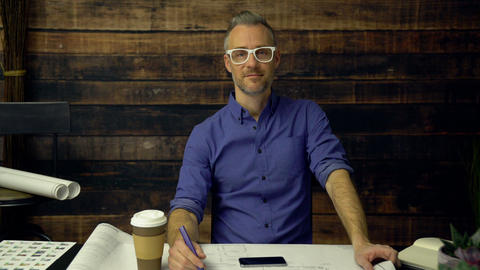 Stylish architect drinks coffee and smiles Footage