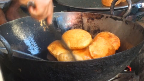 Indian doughnuts are cooked in hot oil Footage